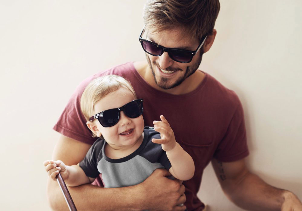 a man and a baby boy wearing sunglasses