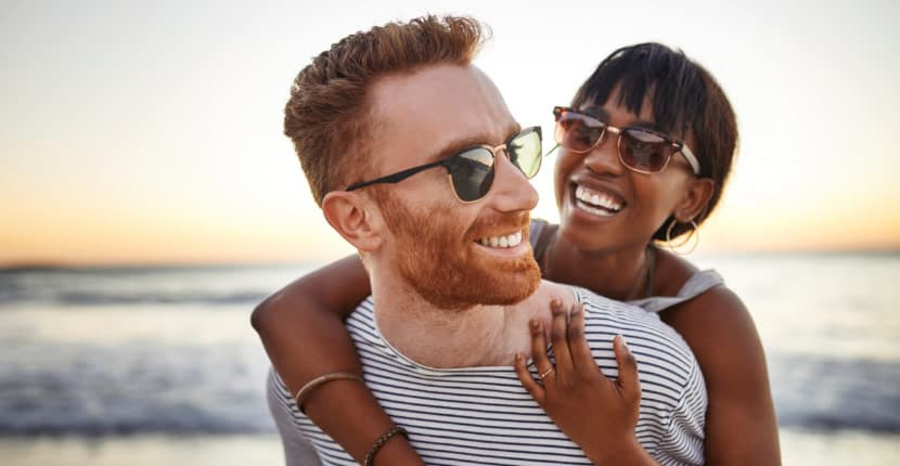 A couple in sunglasses smiling
