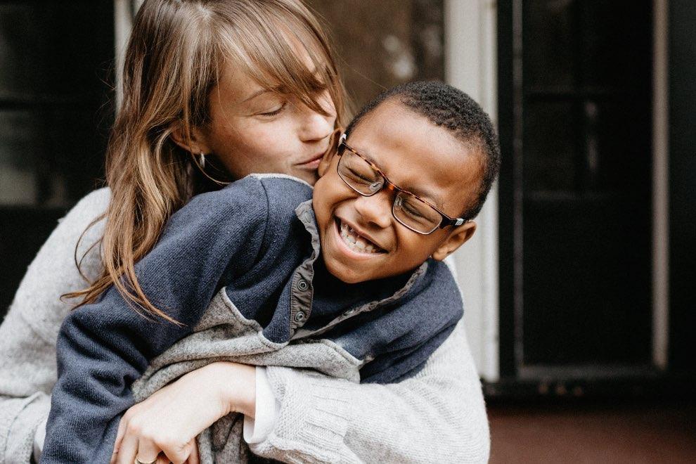 Mom hugging son smiling