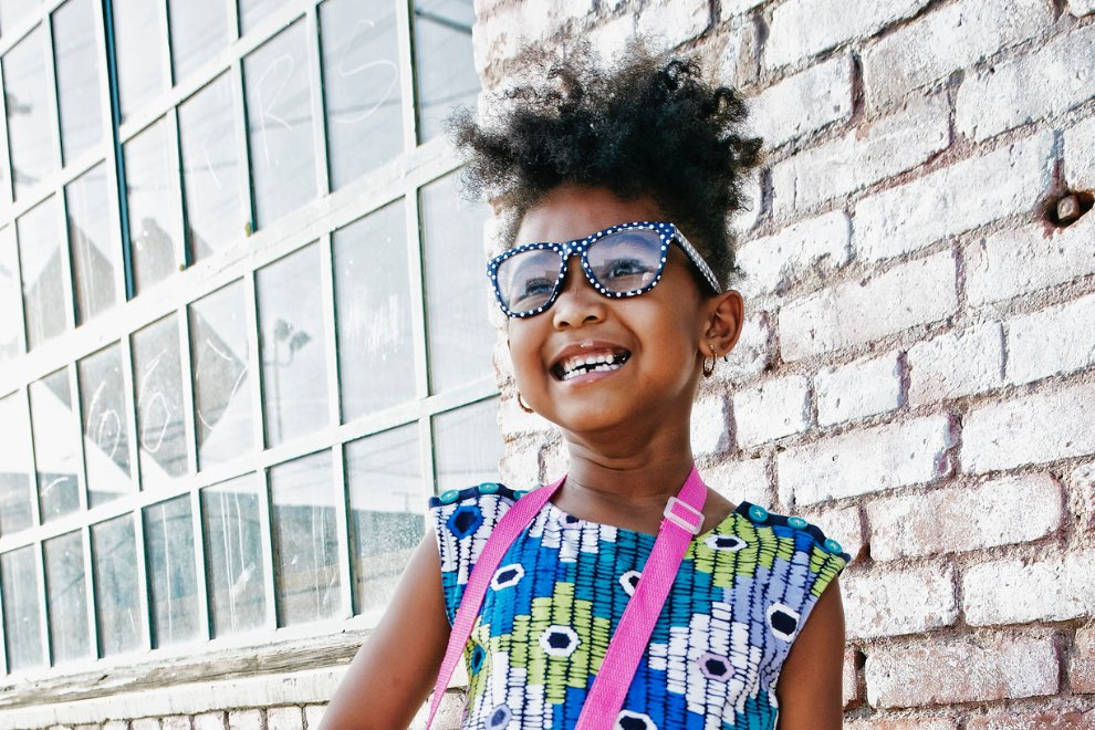 Girl wearing glasses smiling