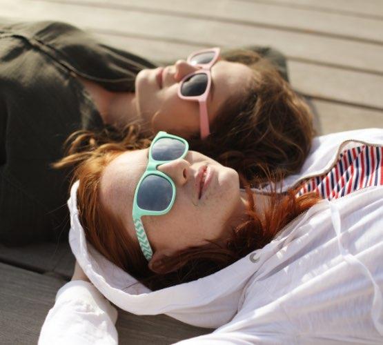 Two teenagers wearing sunglasses