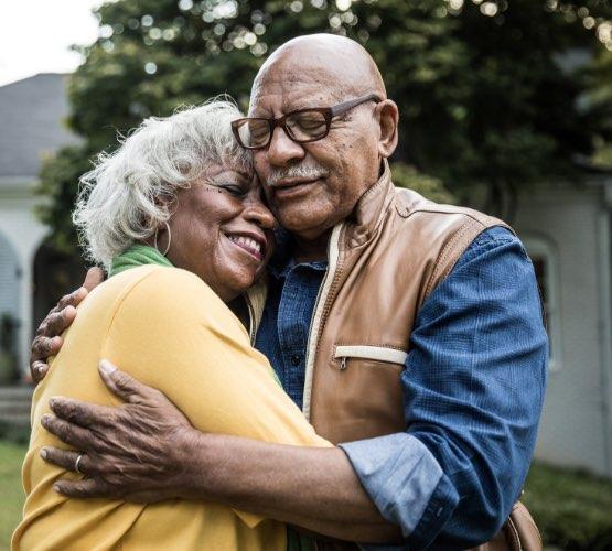 Two seniors hugging